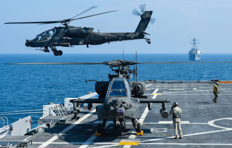 AH-64 Apaches fly off of USS Ponce