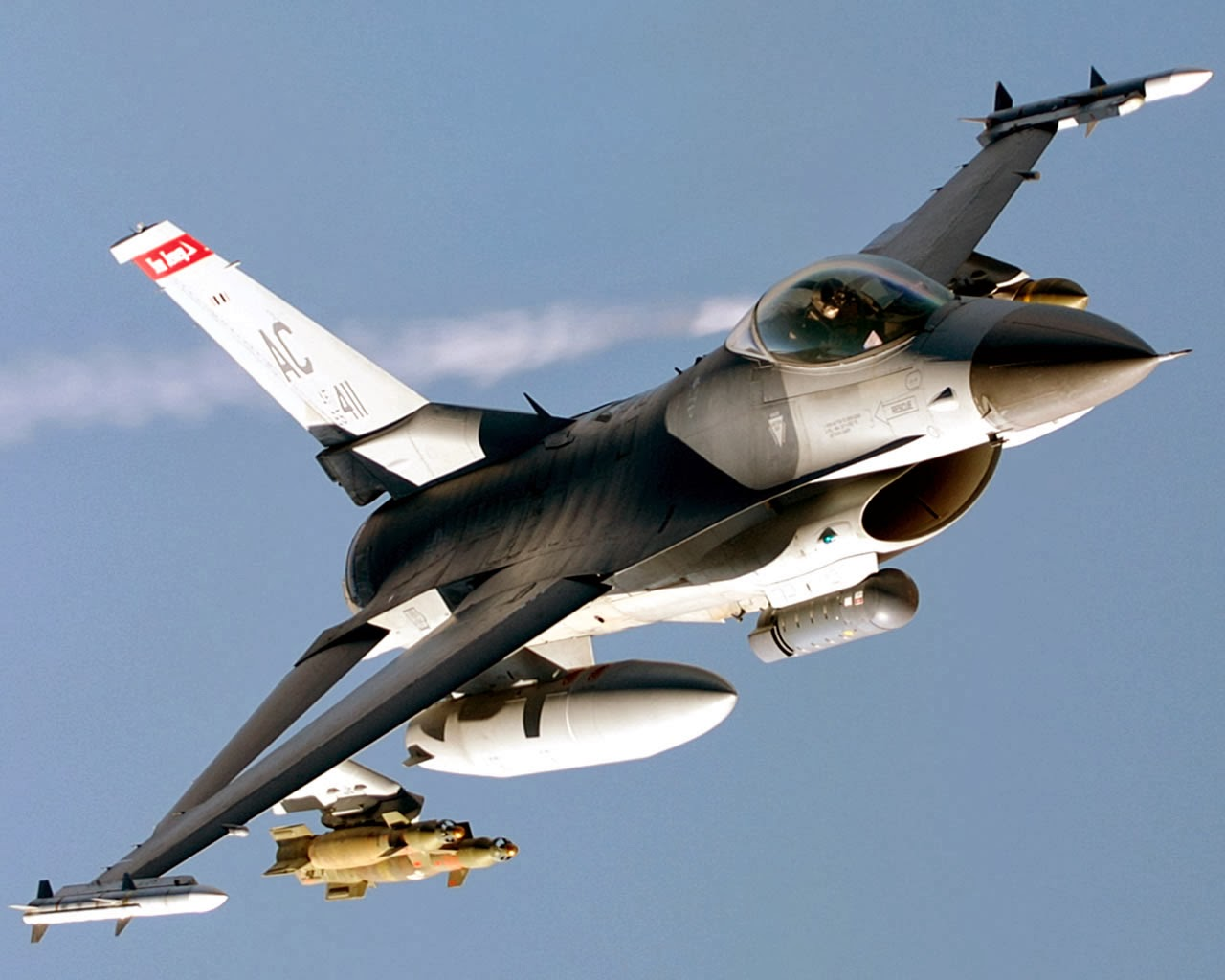 F-16 flying with TER-9/A Triple Ejector Rack