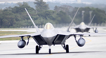 F-22 Raptors on runway at Kadena Air Base